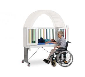 Women accessing cot in wheelchair