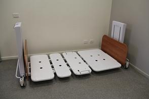 Deutscher Healthcare Big Ted Folding Bariatric Floorline Bed - lowered to floor level