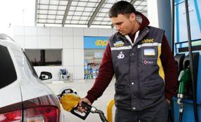 Service Station attendant filling a petrol tank