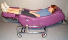 Tilt bed with person lying in it.