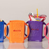 Dwink Box Drink Holder - showing range of colours, with and without drink box and pouch